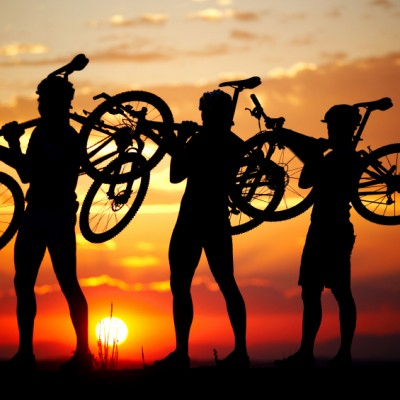 mountainbikers in the sunset